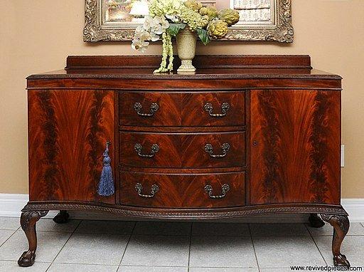 An restored antique wooden sideboard