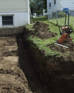 A trench approximately 6 inches deep and 12 inches wide.