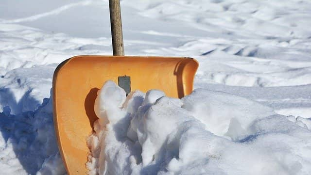 Shoveling snow after heavy snowfall is difficult work.